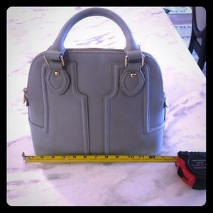 Sole/Society blue vegan leather handbag.
